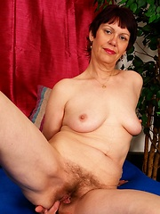 Horny older broad bends over and takes it hard!