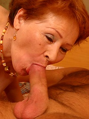 Redheaded granny enjoys riding hard young cock