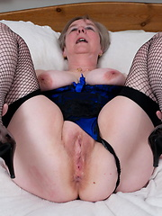 Older granny slaps her shaved vagina
