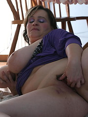 Fat mature touching her round boobs