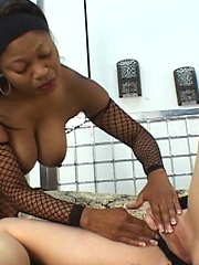 Black mummy in pantyhose is satisfying her girlfriend
