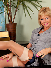 Aged blonde teacher showing her shaved pussy