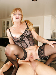 Incredible blonde mom Nina fucking with young buddy on kitchen