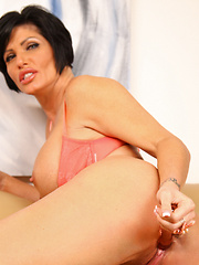 Big-titted mature playing with glass sex toy