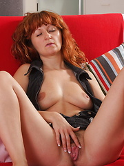 Horny red mature slut playing with her pussy