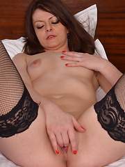 Lovely mature lady playing with her wet pussy