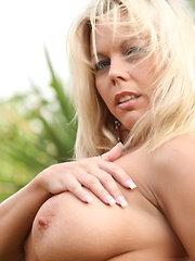 The sexy MILF Amber Lynn Bach strips out of her bikin showing her curvy body.