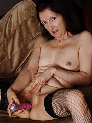 Horny mature slut masturbating and playing with toys