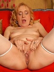 Blonde mature slut getting herself wet