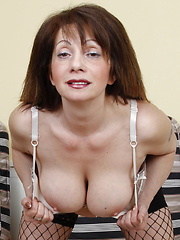 Big breasted MILF playing with her luscious body