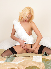 Classy milf babe in stockings spreads her sweet pink pussy