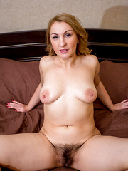 Horny mature woman with soft curves teases her wet hairy pussy
