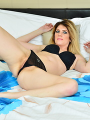 Steamy hot hairy British mom playing on bed