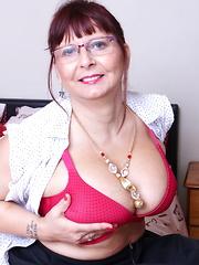 Big breasted British mature slut getting naughty